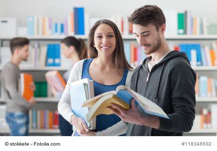 Happy students in the library