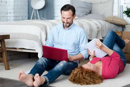 Middle-aged couple spending time on floor